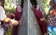 Γυναίκα κόλλησε... μέσα σε δέντρο! (video)