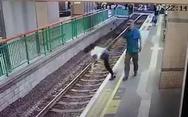 Άνδρας σπρώχνει γυναίκα στις ράγες του τρένου και... φεύγει (video)