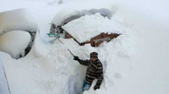 'Θαμμένες' στο χιόνι Γερμανία και Αυστρία (pics)