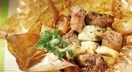 Χοιρινό γεμιστό στη λαδόκολλα