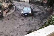 Οδηγός καταφέρνει να ελέγξει το αυτοκίνητό του, που παρασύρεται από χείμαρρο (video)